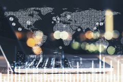 Laptop and digital world map with financial chart. Double exposure with laptop at blured background and digital financial chart with world map illustration. 3d royalty free stock images
