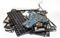 Laptop Computer Disassembled into Broken Pieces Stock Photo