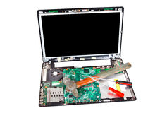 Laptop disassembled with hammer and screwdrivers on it Royalty Free Stock Photo