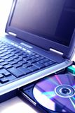 Laptop and a disc Royalty Free Stock Images