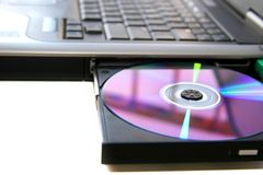 Laptop and a disc. A black laptop with disc in it Royalty Free Stock Photography