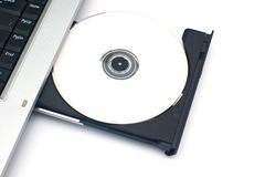 Laptop with the disk Royalty Free Stock Image