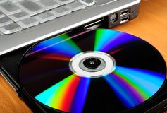 Laptop with disk Stock Image
