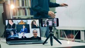 Laptop display showing multiple users during an online lesson