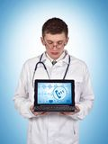 Laptop with 911. Doctor holding laptop with 911 symbol on screen Stock Image