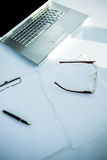 Laptop and document with pen Royalty Free Stock Photos