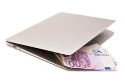 Laptop With Dollars And Euro money Stock Images