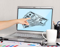 Laptop with dollars Stock Photo