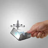 Laptop and dream travel. Business man hand holds laptop and dream travel Royalty Free Stock Photography