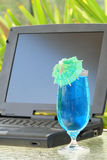 Laptop and drink Stock Photo