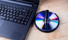 Laptop with dvd disk Stock Photos