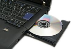 Laptop with DVD Loaded Stock Image