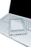 Laptop and e-book Royalty Free Stock Photo