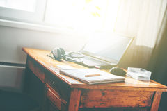 Laptop Earphones Mouse Vintage Table Royalty Free Stock Photos