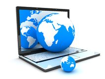Laptop and earth Stock Photography