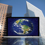 Laptop with earth Stock Photos