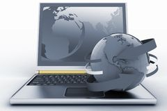 Laptop with earth and arrow Stock Photography