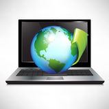 Laptop with earth globe and green arrow Royalty Free Stock Photography