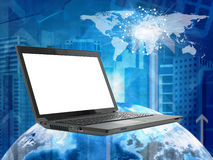 Laptop with earth model on abstract cityscape Stock Photo