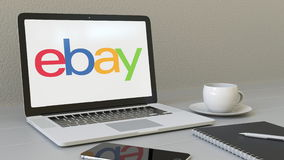 Laptop with eBay Inc. logo on the screen. Modern workplace conceptual editorial 3D rendering. Laptop with eBay Inc. logo on the screen. Modern workplace royalty free illustration