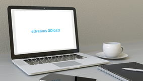 Laptop with eDreams ODIGEO logo on the screen. Modern workplace conceptual editorial 3D rendering Royalty Free Stock Photos