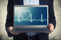 Laptop with ekg on the screen Royalty Free Stock Photo
