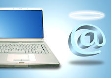 Laptop and Email Angel. Laptop and angel email symbol with halo Stock Images