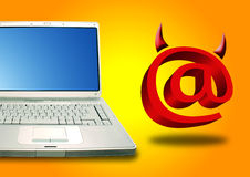 Laptop and Email devil. Laptop and Email symbol in devil shape Stock Photography
