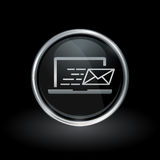 Laptop email send icon inside round silver and black emblem. Notebook mail delivery symbol with laptop email send icon inside round chrome silver and black Stock Photo