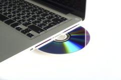 Laptop en CD Royalty-vrije Stock Afbeeldingen