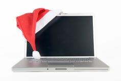 Laptop en de hoed van de Kerstman Royalty-vrije Stock Afbeelding