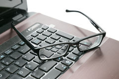Laptop en glazen Royalty-vrije Stock Fotografie