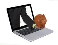 Laptop en spaarvarken Royalty-vrije Stock Afbeelding
