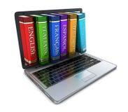 Laptop en vreemde taal Stock Afbeelding