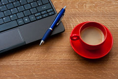 Laptop and Espresso Coffee Royalty Free Stock Photos