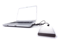 Laptop and a external disk Stock Image