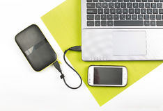 Laptop with external hard disk and cell phone Royalty Free Stock Images