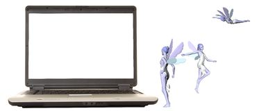 Laptop Fairies. Laptop computer with 3 fairies looking on Stock Photography