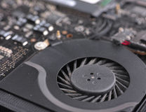 Laptop fan with dust in it and system board Royalty Free Stock Photos