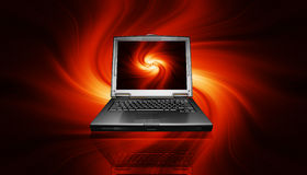 Laptop on fiery background. 3D render of a laptop on a fiery background Royalty Free Stock Images