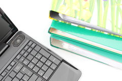 Laptop and file folders on white background Royalty Free Stock Image