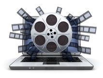 Laptop and film. Laptop and abstract film (done in 3d Stock Image