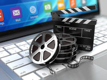 Laptop, Film and Clapper board - video icon. 3d rendering Royalty Free Stock Photo