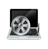 Laptop and film reel isolated on white Stock Photography