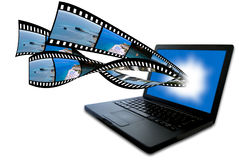 Laptop with filmstrip. Images filyng out of the screen Royalty Free Stock Image