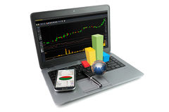 Laptop with financial items Royalty Free Stock Images