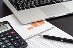 Laptop financial paper Royalty Free Stock Image