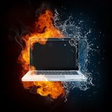 Laptop in Fire and Water. Isolated on black Bacground Stock Image