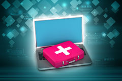 Laptop with first aid box Stock Photo