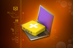 Laptop with first aid box Stock Photography